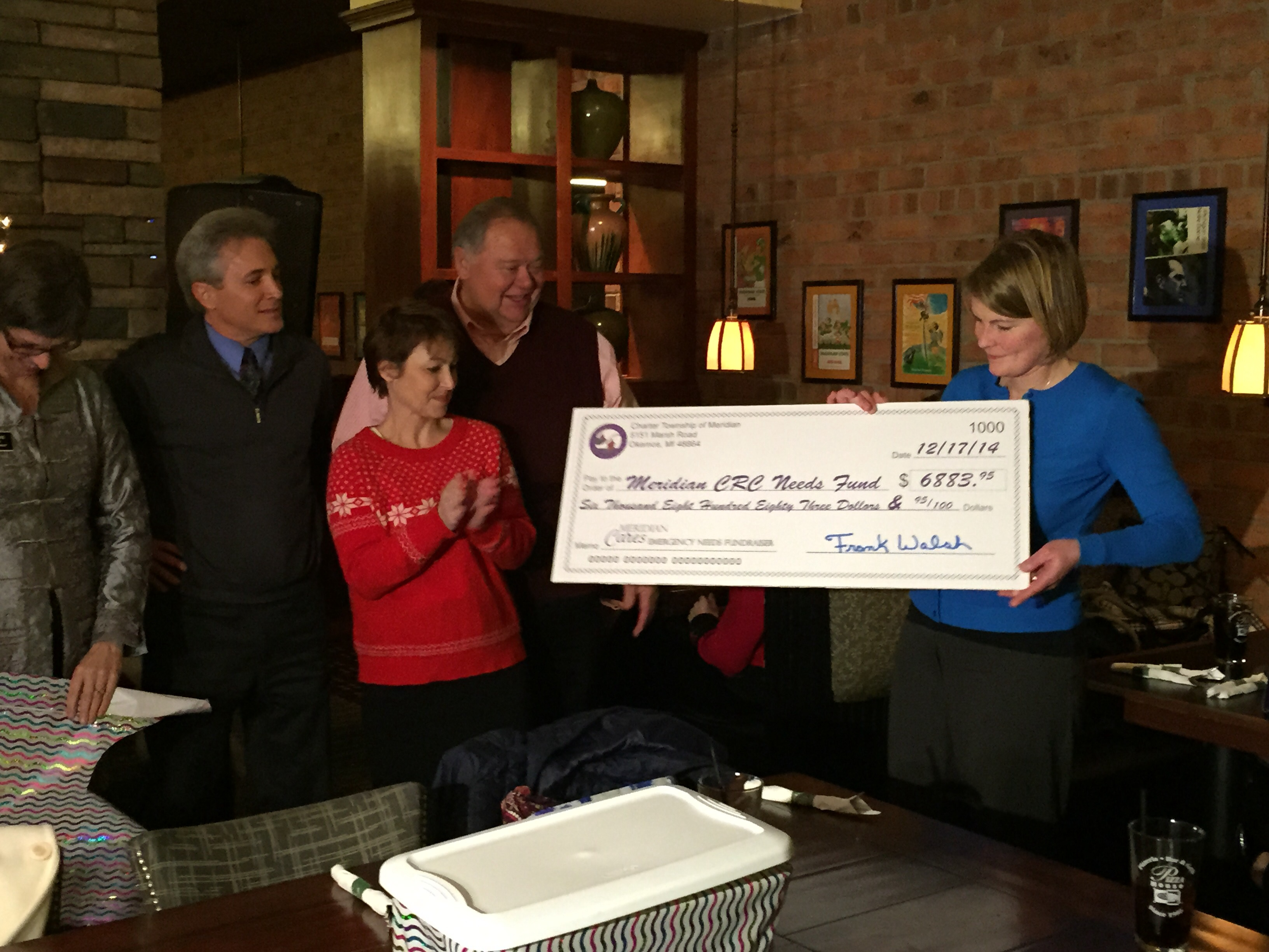 Meridian Cares Program Exceeds Goal; $6,883 Check  Presented to Help Those in Need